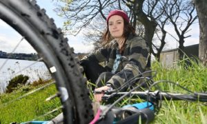 Sports fanatic Rachel Bennet, pictured near the River Dee, Aberdeen, has been blogging her recovery story after suffering two herniated discs.