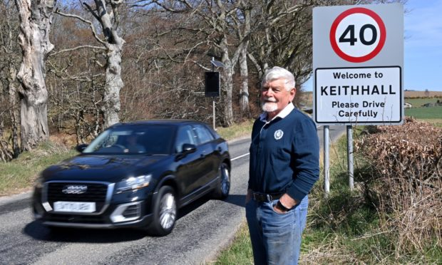 Denys Wheatley says the Keithhall sign should be moved along the road.