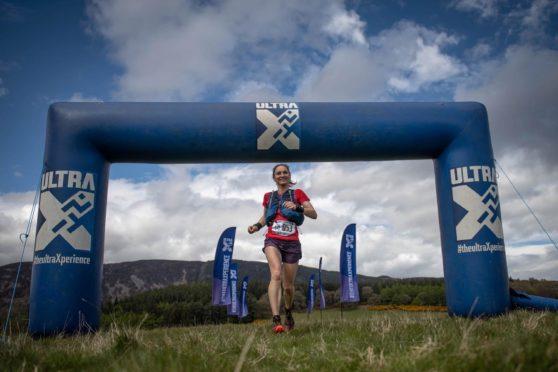 Oldmeldrum's Meryl Cooper winning the Ultra X Scotland 50k race.