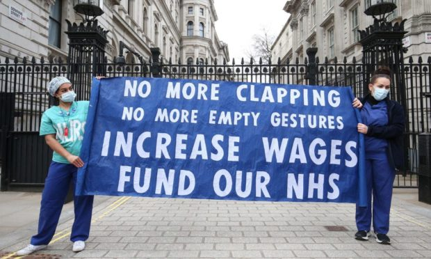 Nurses and NHS workers hold a socially distanced protest outside Downing Street in London. Unison says half of Scotland's nurses have contemplated quitting.