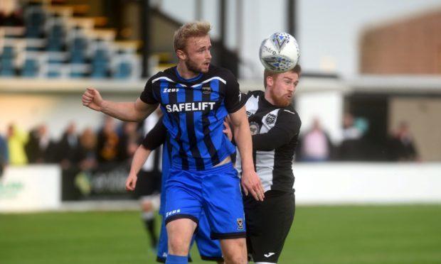 Ross Still, left, in action for Huntly