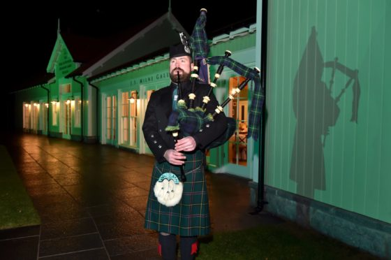 Martin Johnston, official piper of the Braemar Royal Highland Society, has been invited to play a performance as part of the Queen's Platinum Jubilee next year.  Picture by KENNY ELRICK     02/11/2018