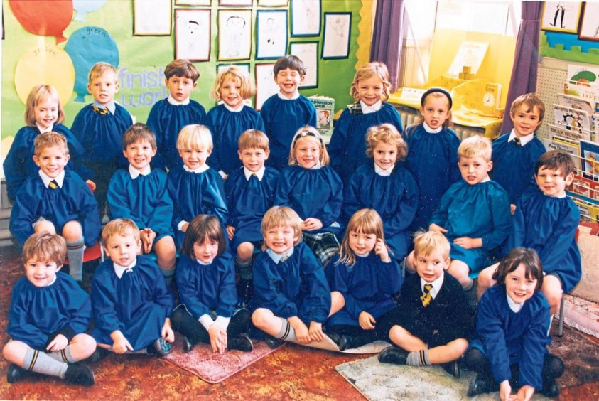 The young pupils from Miss Ferries' primary 1F class line up for their school photograph