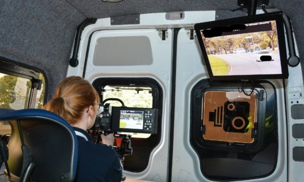 Police staff working in a speed camera unit