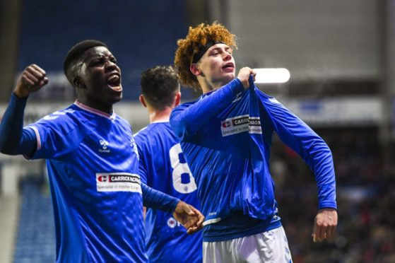 Nathan Young-Coombes celebrates after scoring for Rangers colts against Wrexham in the Challenge Cup.