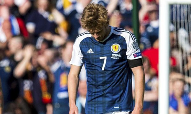 Scotland's Stuart Armstrong looks dejected after the 2-2 World Cup qualifying draw against England at Hampden in 2017.
