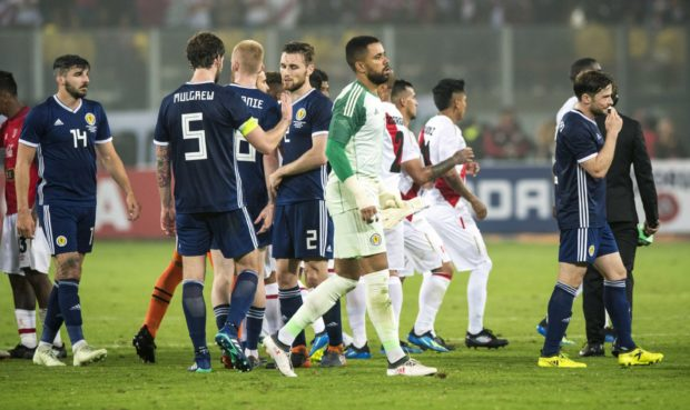 Scotland players at the end of their defeat to Peru.