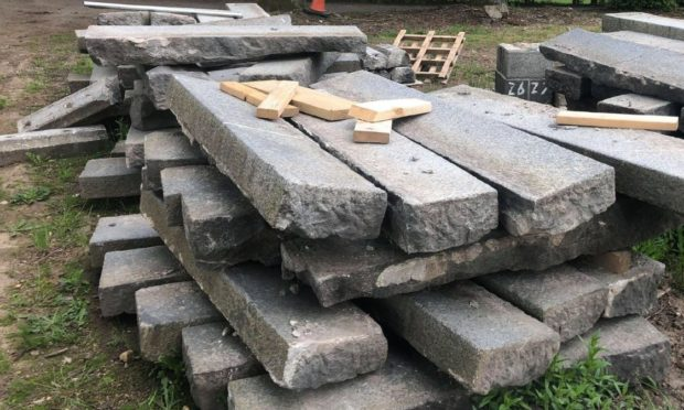 Police have revealed no one - not Aberdeen City Council or Balfour Beatty - has reported a stack of granite, pictured here in an Aberdeen garden, stolen from Union Terrace Gardens.