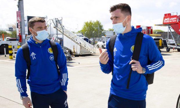 Scotland midfielder John Fleck, left, is still isolating