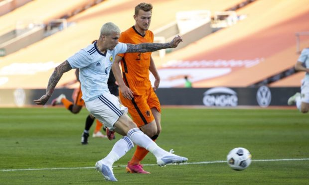 Scotland Forward Lyndon Dykes has a shot on goal during the 2-2 draw with Netherlands.