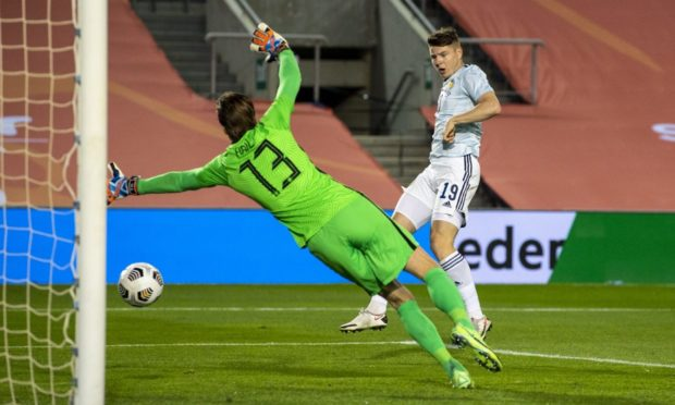 Scotland's Kevin Nisbet scores to make it 2-1 during against the Netherlands