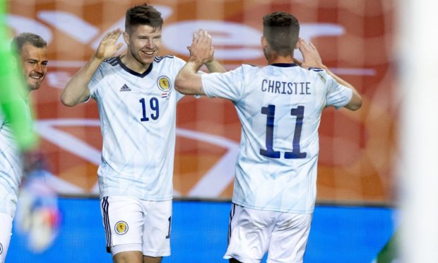 Kevin Nisbet celebrates his goal against Netherlands with Ryan Christie.