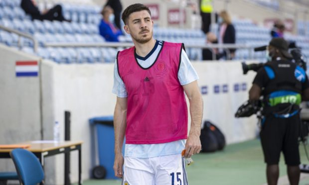 Declan Gallagher readies to come on for Scotland against Netherlands