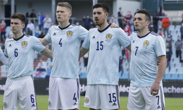Declan Gallagher, third from left, lines up ahead of the friendly against Luxembourg alongside Kieran Tierney, Scott McTominay  and John McGinn.