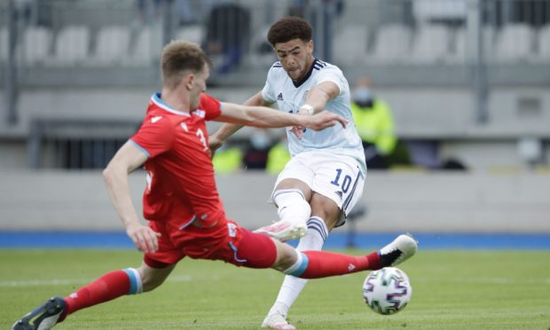 Che Adams, right, scoring for Scotland against Luxembourg.