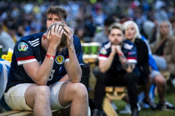 A dejected Scotland supporter at the Euro Fan Zone during Scotland's Euro 2020 campaign