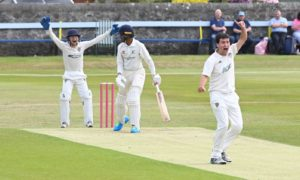 Aberdeenshire wicket keeper Joseph Horne and bowler David Gamblen appeal for out aganist Gordonians' Pranav Saravanan.
