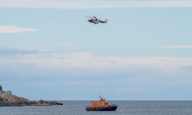 Buckie lifeboat and the coastguard rescue helicopter from Inverness were involved in the rescue. Picture by Brian Smith