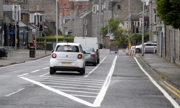 The one-way system in Rosemount Place, with parking in the middle of the road and the bike lane on the right hand side.