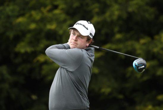 Robert MacIntyre in mid-swing at the British Masters in 2021
