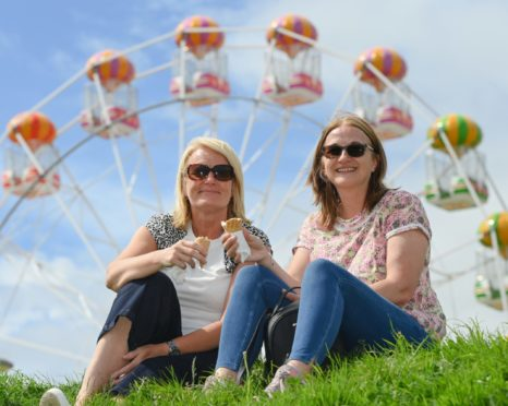 Kerry Colton (left) and Wendy Dean enjoying the sun. Picture by Kenny Elrick.