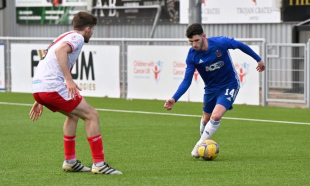 Adam Livingstone in action for Cove Rangers.