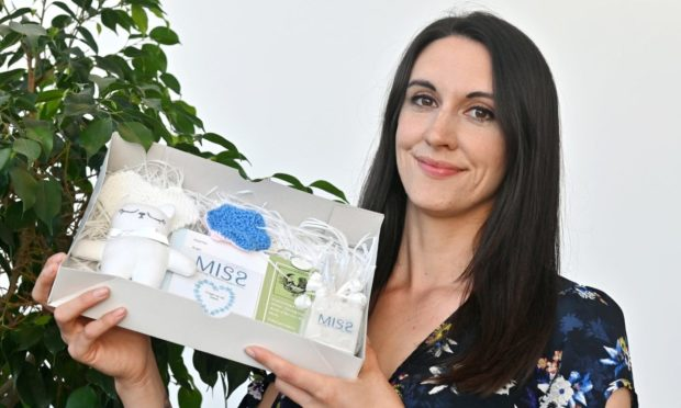 Abi Clarke (Miss chairwoman) with a memory box for early pregnancy loss.