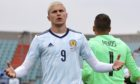 Scotland's Lyndon Dykes reacts during the international friendly soccer match between Luxembourg and Scotland at the Josy Barthel Stadium in Luxembourg, Sunday, June 6, 2021. (AP Photo/Olivier Matthys)