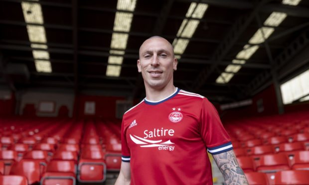 ABERDEEN FC NEW SIGNING SCOTT BROWN PHOTOGRAPHED IN THE CLUB'S NEW HOME STRIP WHICH HAS BEEN ANNOUNCED  PIC OF SCOTT BROWN AT PITTODRIE STADIUM ABERDEEN  PIC DEREK IRONSIDE / NEWSLINE MEDIA
