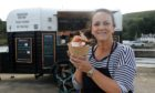 Maria Lewis, owner of  Seafood Bothy, offers weekly seafood specials out of a renovated horse trailer at Old Pier, Stonehaven.