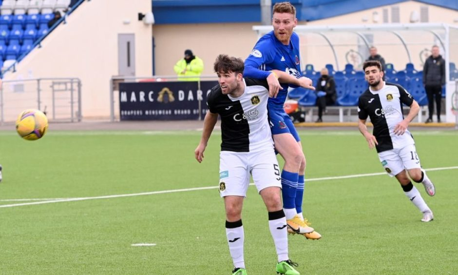 Morgyn Neill in action for Dumbarton against Cove Rangers.