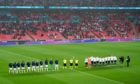England and Scotland players line up on the pitch ahead of the UEFA Euro 2020 Group D match at Wembley Stadium, London.