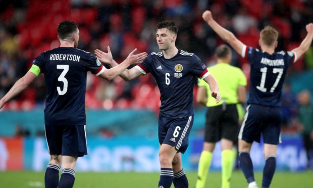 Scotland's Andrew Robertson (left) and Kieran Tierney react after the UEFA Euro 2020 Group D match at Wembley.