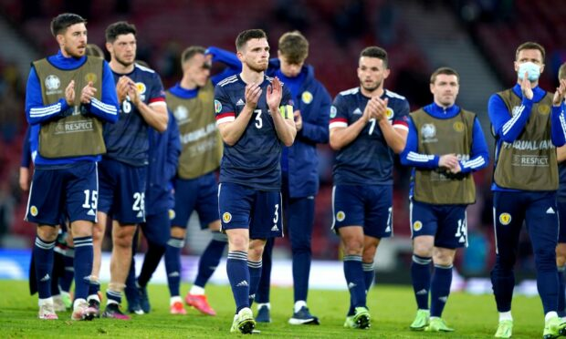 Scotland's Andrew Robertson applauds the fans after the UEFA Euro 2020 Group D match at Hampden Park, Glasgow. Picture date: Tuesday June 22, 2021. PA Photo. See PA story SOCCER Scotland. Photo credit should read: Andrew Milligan/PA Wire.   RESTRICTIONS: Use subject to restrictions. Editorial use only, no commercial use without prior consent from rights holder.