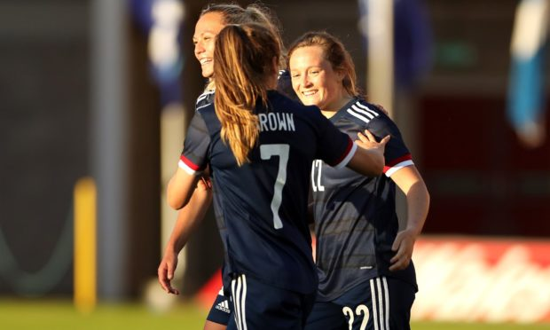 Scotland's Erin Cuthbert (right) celebrates scoring her side's goal against Wales.