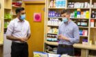 Health Secretary Humza Yousaf and Michael Anderson, deputy manager of McPherson's Pharmacy
