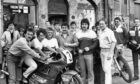Scottish motorcycle road-race champion Brian Morrison, front left, performs the official opening of Shirlaw's Honda motorcycle dealership, 52 The Green, Aberdeen, in 1987. With him are, from left, promotion girls Sandi Barnett and Anne Keen, managing director Roy Shirlaw, salesman Alan Innes and world Grand Prix motocross contender Willie Simpson.