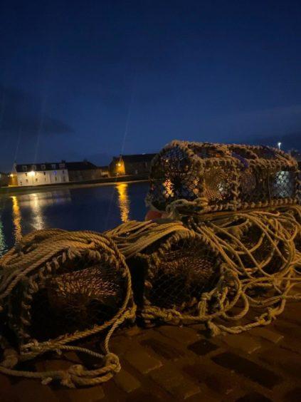 VA May - RediscoverABDN - Lauren Foreman - Reflections on the calm waters of Stonehaven Harbour