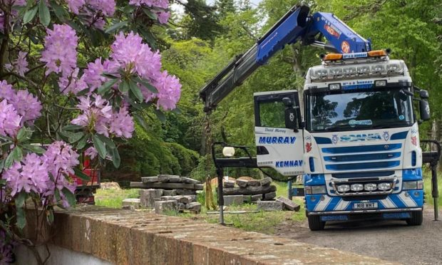 A lorry loads the AWOL granite from Union Terrace Gardens onto a Graeme Cheyne flatbed van.