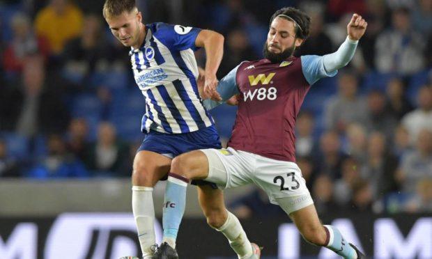 Teddy Jenks of Brighton under pressure from Jota of Aston Villa.