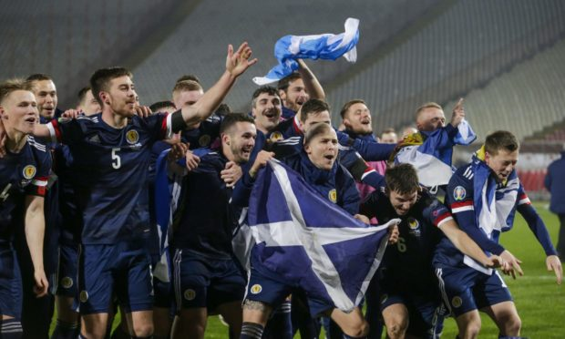 Scotland's players celebrate after winning the penalty shootout of the UEFA EURO 2020 qualification playoff match between Serbia.