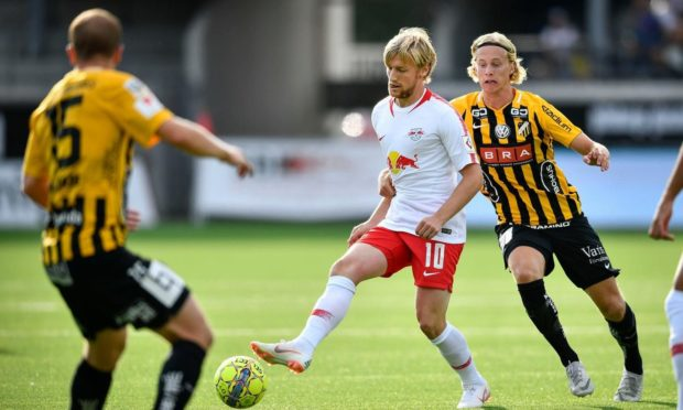 RB Leipzig's Emil Forsberg (C) is chased by Hacken's Gustav Berggren (R) - who is still at the club - during a UEFA Europa League second round qualifier in 2018.