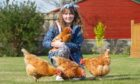 This week's winner, Neve Watson from Elgin, with the four family hens, from left, Bella, Pumpkin, Raquel and Neve is holding Henrietta.