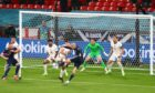 Lyndon Dykes of Scotland has this shot cleared off the line by Reece James of England at Wembley.