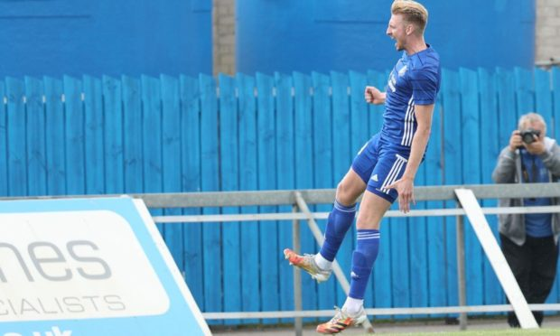 Russell McLean celebrates putting Peterhead 3-1 up against Cove.