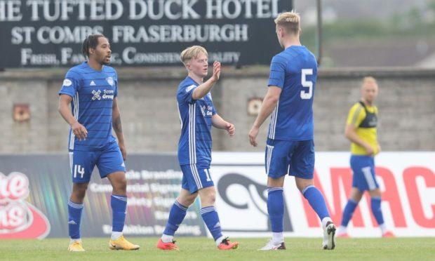 Peterhead's Lyall Cameron (centre) celebrates his goal against Cove Rangers.