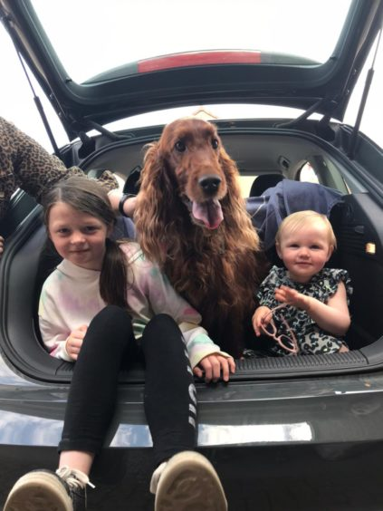 Shelley Kingsley, from Turriff, sent in this photo of Jessica and Grace with red setter Rubie.