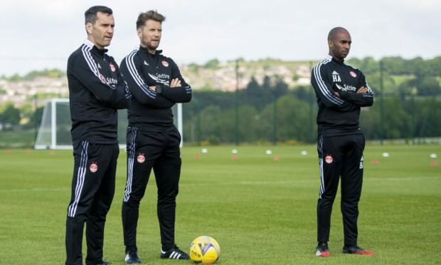 Manager Stephen Glass alongside coaches Allan Russell and Henry Apaloo.