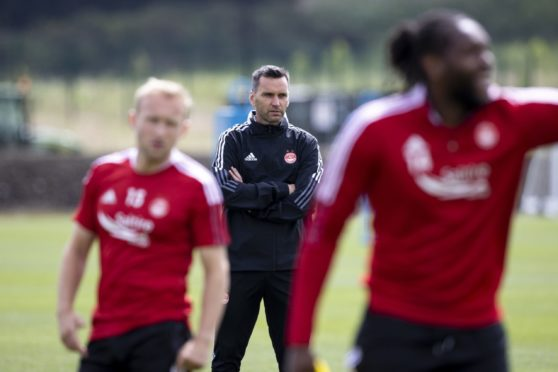 Aberdeen manager Stephen Glass oversees training at Cormack Park ahead of the new season.