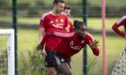 Jay-Emmanuel Thomas sprints during Aberdeen training.